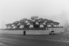 Dochula Chortens (sushilpatro) Tags: red wheel fog handicraft airport peace technology child bhutan wine market tea buddha label prayer monk buddhism flags funeral monastery walker valley plantation gateway taktsang 108 stupas johnie tzatzas