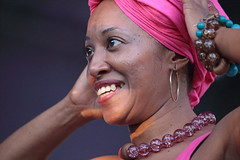 Lady In Pink (peterkelly) Tags: digital ontario womenexpression canada northamerica canon 6d kultrunfestival kitchener betsaydamachado venezuela afrovenezuelan music concert necklace smiling smile woman bracelet earring pink 2016 musician
