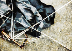 Limited Warranty (Steve Taylor (Photography)) Tags: blue brown white black art broken metal digital umbrella silver rust floor distorted spokes fabric damage smashed bent brolly collapsed