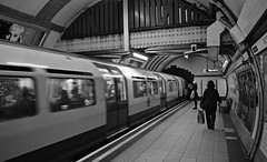 Russel Square Underground Station Monochrome. (giannipaoloziliani) Tags: city people blackandwhite london monochrome station train underground downtown metro unitedkingdom citylife londres metropolis londra metropolitana biancoenero russelsquare urbanlife waithing urbancitylife pubblicservice giannipaoloziliani