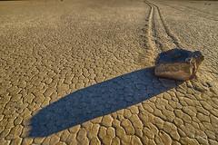 Sliding Rock of Racetrack Playa (Lake Vermilion1) Tags: california sun southwest racetrack nationalpark rocks desert mud wind dry deathvalley cracks sliding mysteries racetrackplaya drylake deathvalleynationalpark slidingrocks borderfx