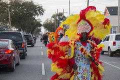 Flag boy Leroy Ross of the Golden Arrows leads the way down Orleans avenue to the Carver theater for the memorial for Big Chief Bo Dollis Sr.