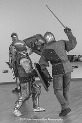 [2015-02-22@15.00.47a] (Untempered Photography) Tags: monochrome training fight helmet medieval teen sword shield armour reenactment canonef24105mmf4lisusm platearmour gambeson barbute untemperedeye canoneos5dmkiii kernowlevy otterhamandstjuliothall untemperedeyephotography