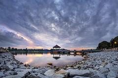 Sunset at Lower Peirce Reservoir, Singapore (gintks) Tags: seascape reflection water landscapes singapore glow dramaticsky dramaticclouds singaporetourismboard gintks gintaygintks
