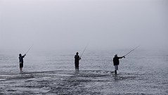 Casting in the Fog (imageClear) Tags: lowcolor fishing fishermen casting northpoint sheboygan wisconsin nikon aperture sport fish rods waders lake lakemichigan d600 80400mm imageclear flickr photostream