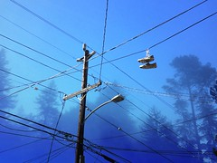 Natural city (eviloars) Tags: blue sky urban fog oakland shoes sneakers karl hanging enlight