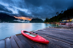 Khao Sok (keangs) Tags: travel sunset red summer sky cloud sun sunlight mountain lake reflection green tourism nature water beautiful beauty forest river landscape thailand boat ship outdoor dusk background scenic vessel national barge