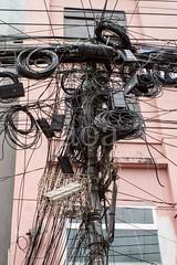 H504_3518 (bandashing) Tags: wires tangled cables electric pylon mess crude street building sylhet manchester england bangladesh bandashing aoa socialdocumentary akhtarowaisahmed cctv camera cage