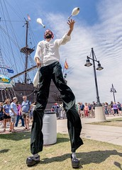 Tall Entertainment (Wes Iversen) Tags: baycity michigan tallshipcelebration tokina1116mmf28 entertainers jugglers men people stilts tallships women juggling