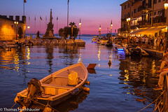 Blue Hour in an italian City (Thomas H_13) Tags: fischerboote hafen italien lnder urlaub bluehour ducks fischingboats habour italiancity italy lakeview life motorboats nightlife nightscape oldbuilding reflections vacation watercapture romantic romanticitaliancity oldtown
