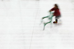 Balancing act (Elios.k) Tags: horizontal outdoors people one girl young alone iceskating skating rind ice chair balance motion movement blur slow shutter speed colour color green red coat white view perspective above angle minimal abstract museumplein travel travelling december 2015 canon 5dmkii camera photography tourism amsterdam northholland noordholland thenetherlands nederland