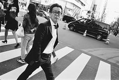 Shinjuku, Tokyo (fabiolug) Tags: man walking crossing glasses suit wind windy car shinjuku people street streetphotography tokyo japan japanese asia leicamp leica mp rangefinder film filmphotography believeinfilm blackandwhite blackwhite bw kodaktrix400 trix400 kodak trix kodaktrix leicaelmarit28mmf28asph elmarit28mmf28asph elmarit28mm leicaelmarit28mm 28mm elmarit leicaelmarit wide wideangle