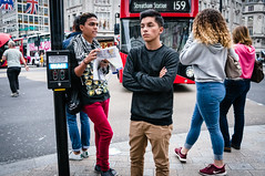 159 (jonron239) Tags: london oxfordcircus boys girls bus post leaning expression gesture foldedarms bodylanguage trainers pullover scarf map guide