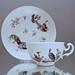 Meissen, Teetasse, Tasse, Rocaillen Relief, Federvieh, Hühner, Gänse, Landschaft, Architektur, Manierblumen