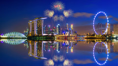 Firework on Singapore Skyline and view of skyscrapers on Marina Bay at twilight time. (Nuttawut Uttamaharad) Tags: architecture asia bay bridge building business center city cityscape commercial downtown dusk east evening exterior famous finance financial hotel landscape light marina modern night panorama reflection river silhouette singapore sky skyline skyscrapers sunset tower travel tree urban view wheel