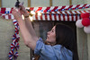 Preparativos (Imthearsonist) Tags: fiestaspatrias chile decoracion preparacion banderas luces mujer chilena costumbres tipicas dieciochodeseptiembre 18 fiestas typical party chilean woman decoration