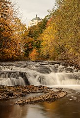Flowing (Karen_Chappell) Tags: river newfoundland nfld stjohns renniesriver nd110 longexposure confederationbuilding canada avalonpeninsula atlanticcanada fall autumn trees water waterfalls orange yellow green nature scenery landscape scenic grandconcourse