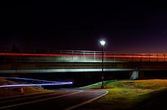 two startled bikers (fallsroad) Tags: longexposure bridge night riverside arkansasriver tulsaoklahoma nikond7000
