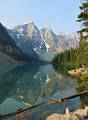 Moraine Lake ~ morning mirror (karma (Karen)) Tags: trees canada mountains topf25 reflections rocks lakes pines alberta glaciers 4summer morainelake canadianrockies banffnp canadanationalparks