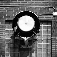 Unique fan (Berkehaus) Tags: urban white black brick glass wall fan back alley unique monotone block heating cooling