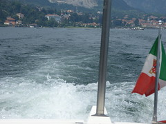 Lake Maggiore - waves created by the boat - Italy flag (ell brown) Tags: italianlakedistrict lakemaggoire lagomaggiore greaterlake lagoverbano piedmont italia italy provinceofverbanocusioossola verbanocusioossola golfoborromeo boat waves flag italyflag italianflag boats