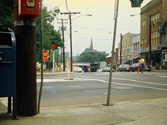 Slightly blurry view of downtown at the Broad and River Street intersection. Lots of enormously long 1970s cars are parked on the street. So many stores which are long gone appear in this view. An old fire alarm is visible. Milford Connecticut. July 1975 (wavz13) Tags: oldphotographs oldphotos 1970sphotographs 1970sphotos oldphotography 1970sphotography vintagesnapshots oldsnapshots vintagephotographs vintagephotos vintagephotography historicphotographs historicphotos historicphotography 110 110film instamatic vintagemilford oldmilford 1970smilford vintagewoodmont oldwoodmont 1970swoodmont connecticutphotographs connecticutphotos oldconnecticutphotography oldconnecticutphotos oldconnecticut vintageconnecticut connecticutphotography vintagenewengland oldnewengland 1970snewengland vintagenewenglandphotography oldnewenglandphotography vintagenewenglandphotos oldnewenglandphotos vintagecars vintagecar oldcar oldcars 1970scars 1970scar collectiblecars collectablecars grain grainy subminiature submini oldstores vintagestores churchspires spires hotpants shortshorts pointilism