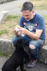 Artist Robin Mason shares his Cornish Pastie with friend Totty (Just Nice Photos) Tags: cornish pastie lunch artist robinmason portscatho dog photography maryalicepollard justnicephotos