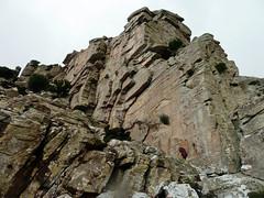 A crest of the ridge seen from below (angeloska) Tags: ikaria hikingtrails opsikarias aegean greece signage    ryakas geli   february girl rocksurface cliff