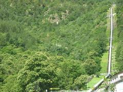 Bernina Express - pipeline (ell brown) Tags: tirano lombardy lombardia italia italy valtellina provinceofsondrio switzerlanditalyboundary switzerland graubnden stmoritz berninaexpress poschiavopontresina worldheritagesite unescoworldheritagesite rhaetianrailway albulaberninalandscapes rhaetianrailwaycompany rhb sightseeing berninarailway berninaline electrifiedrailway berninapass crossborderjointswissitalianheritagearea train tree trees mountain mountains pipeline