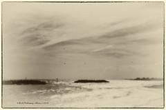 Elmer Beach Pin Hole (Rick Hathaway - rhfo2o) Tags: sea sky blackandwhite bw beach clouds canon vintage mono waves pinhole seadefences canoneos50d rhfo2o