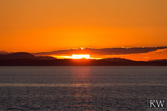 Whidbey Fireball (sleepnever) Tags: ocean sunset sun mountains clouds evening washington pacific northwest whidbey pacnw robertwatts whidbeynas aultfield 100400ii