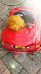 John lets Paige drive his car.