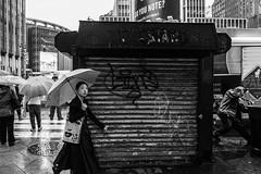 Newsstand (pennuja) Tags: new york city nyc rain yellow umbrella manhattan candid stranger newsstand