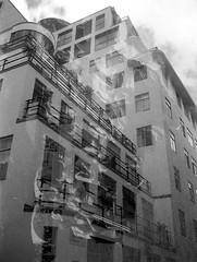 Art Deco Viking Grandmas (Jim Davies) Tags: blackandwhite building london art film monochrome doubleexposure leeds boingboing analogue serendipity expired deco westyorkshire immeuble cosmicsymbol 125asa faringdon olympus35dc filmswap ilovewestleeds filmfilmforever vikinggrandmas