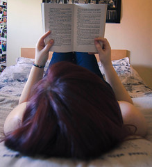 Natural Habitat (Laura Burden Media) Tags: red portrait woman me girl self hair fun happy photography reading book photo bed nikon view arms legs image head good rear relaxing harry potter books hobby literature read pillow photograph reclining cushion facebook d7000