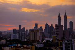 Kualalumpur - Sunrise - Explored (Naina Mohamed) Tags: city morning sun building architecture sunrise canon buildings twin malaysia kualalumpur tamron twintower naina t3i 600d explored nainaphotography tamron16300