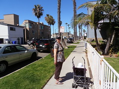 Oceanside, CA (traveling peter) Tags: california road ca street blue shadow sky usa building tree green cars grass facade america standing fence cycling march rust stroller parking rusty bluesky palm sidewalk oceanside palmtree sophia 2015 meggiev year2015