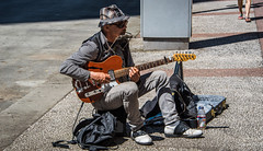 2016 - Vancouver - Gastown - One Man Band (Ted's photos - For Me & You) Tags: 2016 bc tedmcgrath tedsphotos vancouver vancouverbc vancouvercity vignetting city cityofvancouver cropped gastown gastonbackpackhatmusicianplayingguitarguitar player6 string guitarstreet scenepeopleportraitampstrummingguitar caseentertainercans2ssun glassessittingseatedshadowsdoleone bottlecigaretteshoesstringselectric guitar male man mouthorgan
