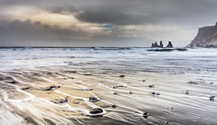 Never a Dull Moment (Jerry Fryer) Tags: clouds dramatic sky coast seascape vik iceland blacksand volcanic golden waves wind surf 5dmk2 ef1635mmf4l lee filters trolls basalt seastacks longexposure beach mar light moody snow cliffs visipix