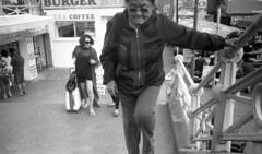 Head On (4foot2) Tags: candidportrate candid streetphoto streetshot street streetphotography people peoplewatching peopleofbrighton interestingpeople reportage reportagephotography brighton seafront seaside promenade steps walk walking analogue film filmphotography 35mmfilm 35mm 35mmf35 35mmf35summaron summaron leica leica111 1932 1932leica rangefinder zonefocus guess shootfromthehip oldfilm outofdatefilm expiredfilm experimental exepan exepan100 bw blackandwhite monochrome mono rodinal standdevelop filmgrain grain 2016 fourfoottwo 4foot2flickr 4foot2photostream 4foot2