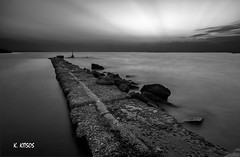 JETTY (kkitsos) Tags: kalamaria greece sunset water sea seawall jetty dock stone beach coast seashore seaside seacoast marine prospect perspective calm tranquil atmosphere outdoor landscape light lighthouse evening night blackandwhite monochrome grey tone contrast colorless grayscale sky gloom dusk nature horizon longexposure slowshutterspeed tripod wideangle filter nikon bw maniac v2