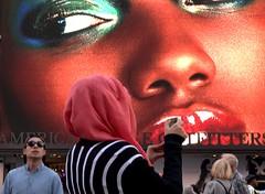 Times Square 146 (stevensiegel260) Tags: billboard timessquare newyork headscarf muslim woman streetphotography
