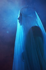 ghost I (Nilacoles) Tags: girl ghost nilacoles photography darkness goth underworld lonely ghosts spirit veil blue cyan backlight light dust smoke woman white wig alternative model