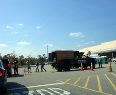 Duracell Power Forward Battery Distribution Truck. (dccradio) Tags: lumberton nc northcarolina robesoncounty hurricanematthew relief aftermath hurricane matthew stormrelief duracell powerforward truck batterydistribution tree trees parkinglot pavement sky