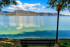 Nature never goes out of style ! (dimitrisrentis) Tags: colour colourful landscape light clouds nature mountain hellas nikon d5200 kastoria lake outdoor orestiada makedonia water green view scenery seaside shore blue bench macedoniagreece timeless macedonian