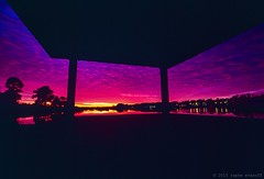 Sky Drama and Roof Overhead (Raphe Evanoff) Tags: leica sunset sky film water america colorful vibrant dramatic northcarolina negativespace velvia magichour