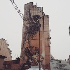 Beautiful mural on a side of a 9 story building. #mural #streetart (reverywhere) Tags: square greece macedonia squareformat timeless makedonia  iphoneography instagramapp uploaded:by=instagram foursquare:venue=4f6ba6afe4b01489b7efeac9