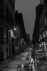 Out in the Rain (Mike Kniec) Tags: street city bw blur rain canon walking manchester graffiti raining walkers darkcity rainycity manchesterstreet walkingintherain manchestercitycentre canon40d manchesterstreets