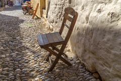 Rhodes (Andreas Mariotti) Tags: street stone chair alley cobblestones greece boulders griechenland rodos rhodes stuhl folding gasse klappstuhl egeo stase kopfsteinpflasterster