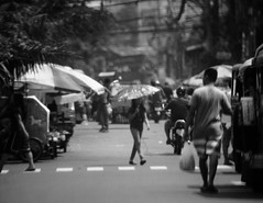 IMG_8813 (RV Henretty-Jornales) Tags: street people blackandwhite woman white man black umbrella walking asian asia market candid tricycle philippines streetphotography wires manila filipino series trike pinay pinoy jeepney